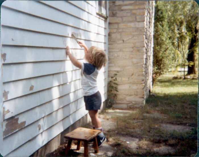 Here I am at age three, attempting to help out with some paint scraping.